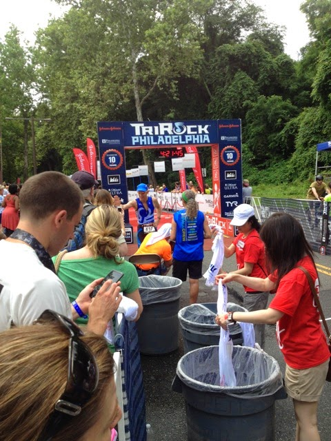 a member of Team Endless Pools at the TriRock Philly triathlon finish line