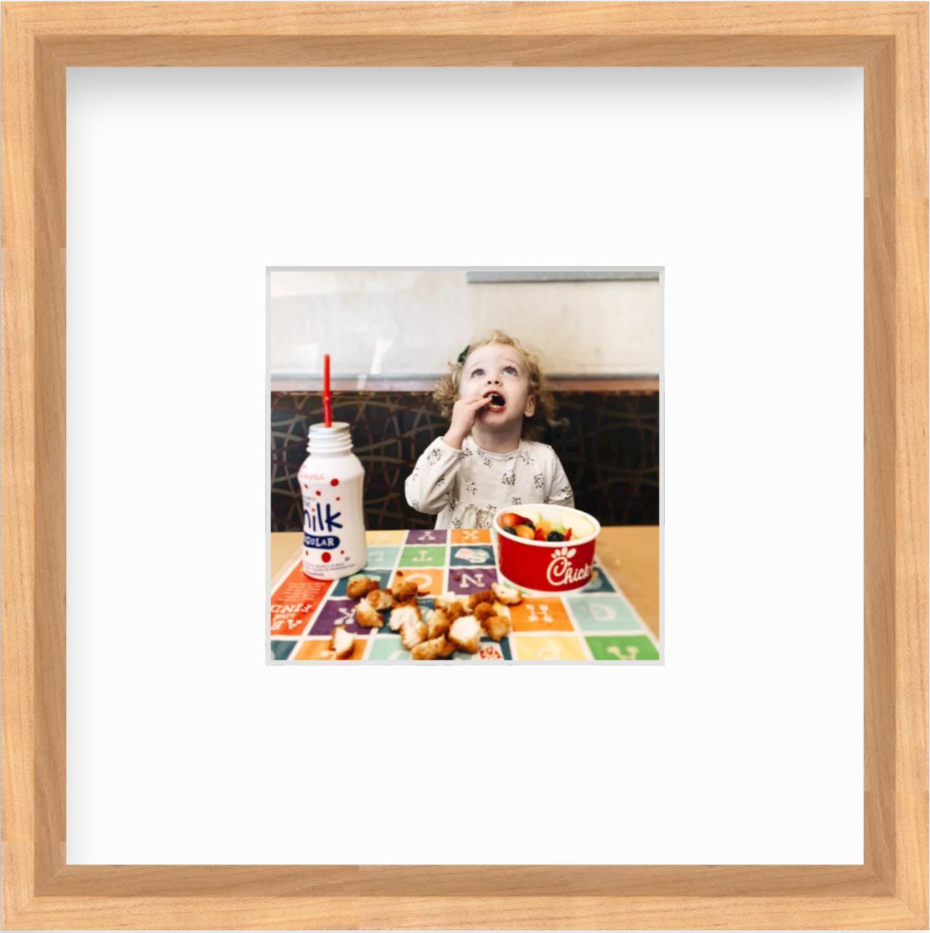 framed photo of girl eating