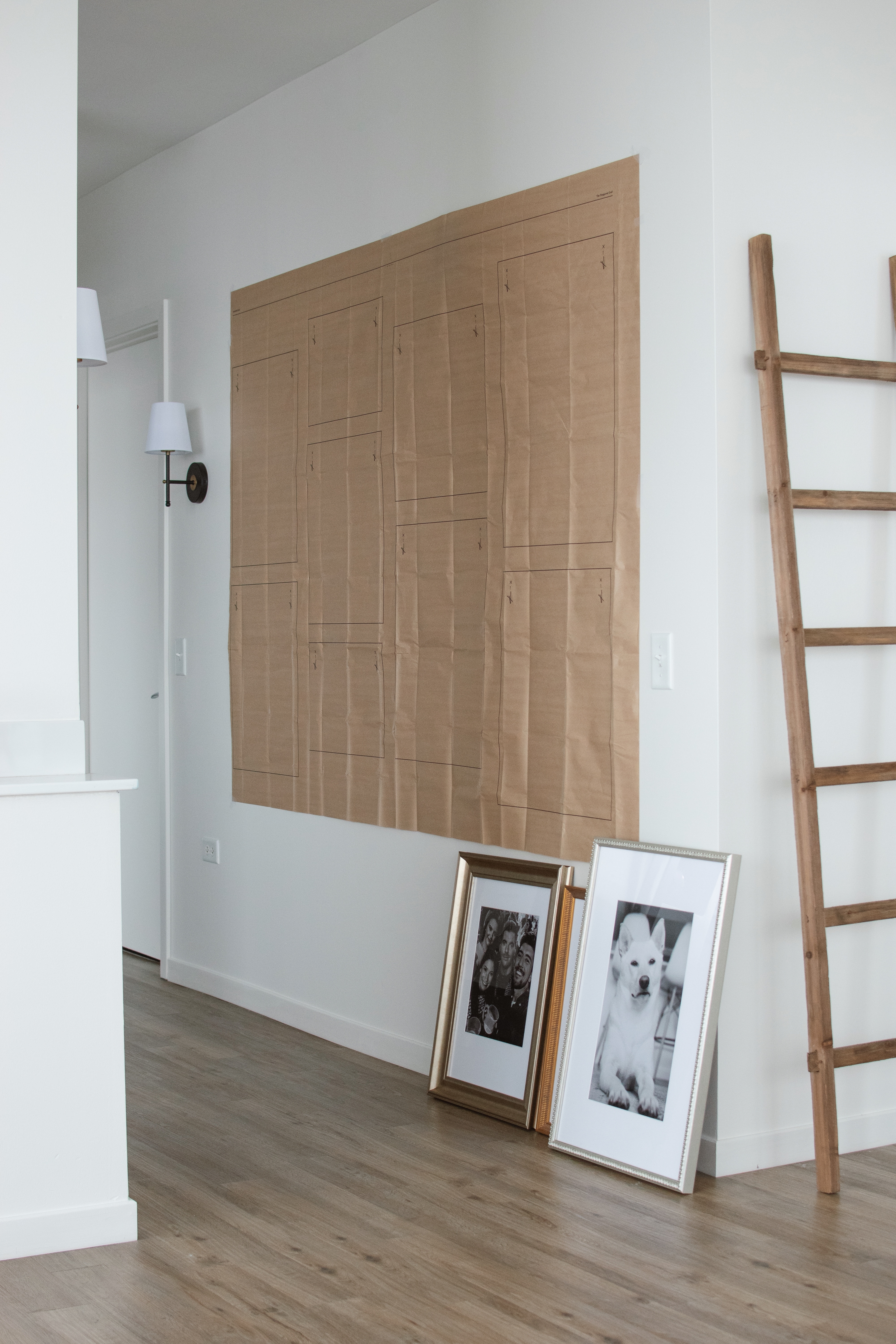 hanging guide for staggered grid gallery wall