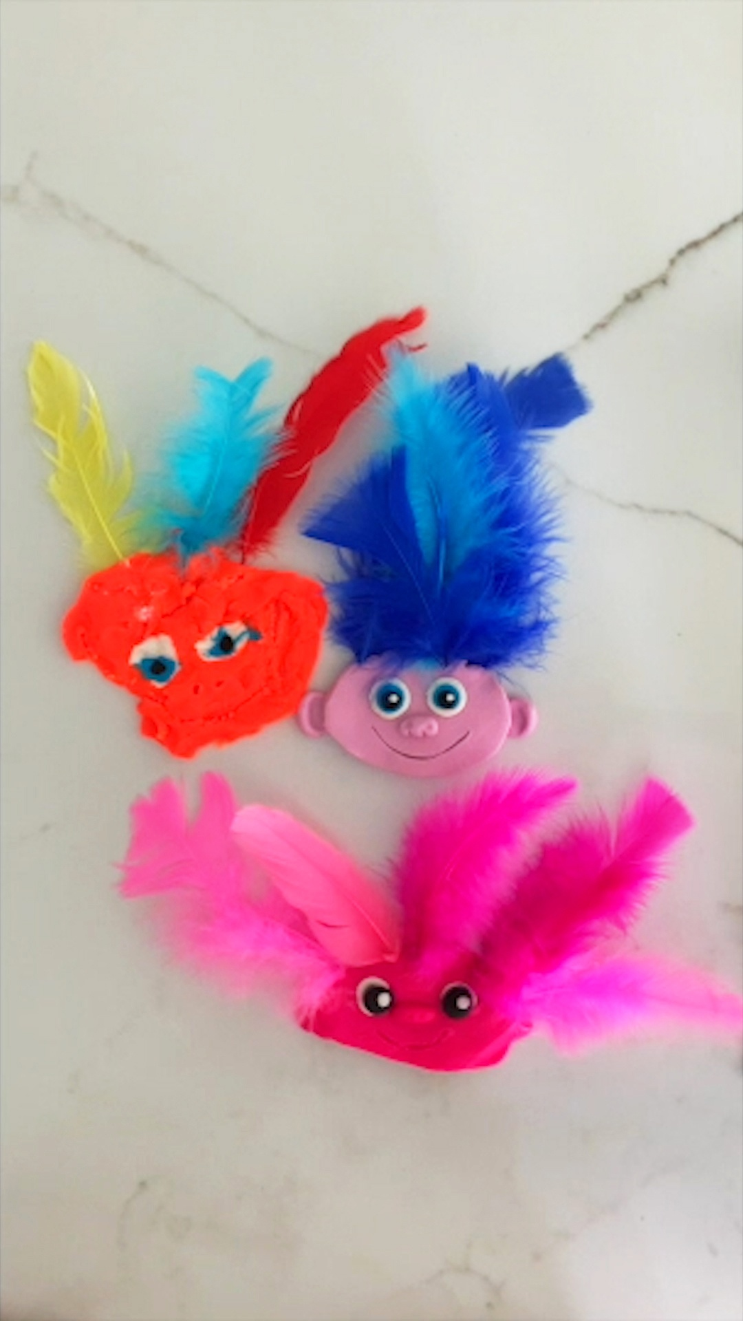 Play-Doh art in the shape of trolls