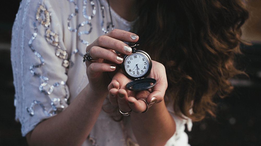 Woman holding antique watch