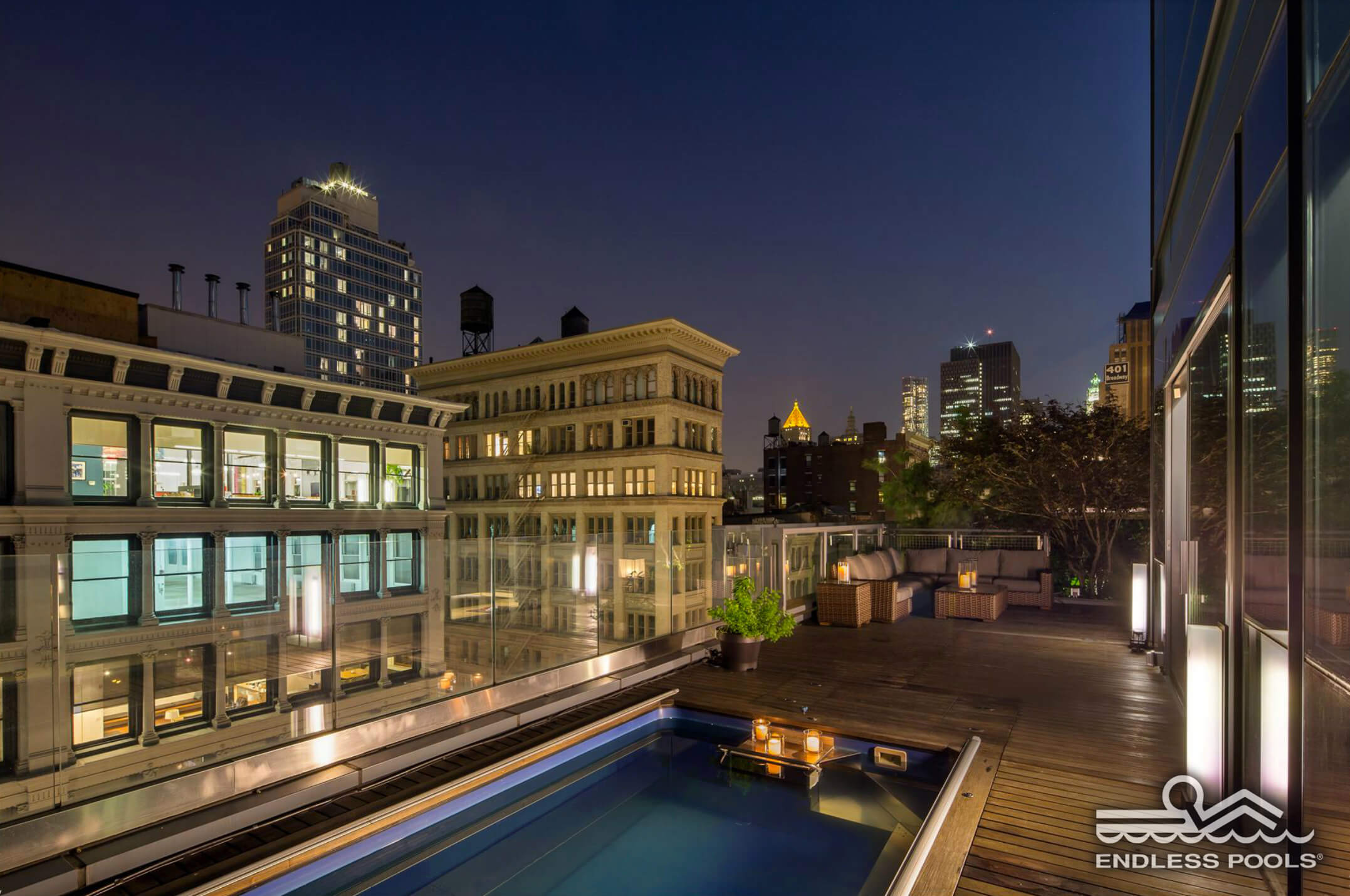 a rooftop Endless Pool at night in New York City's SoHo district