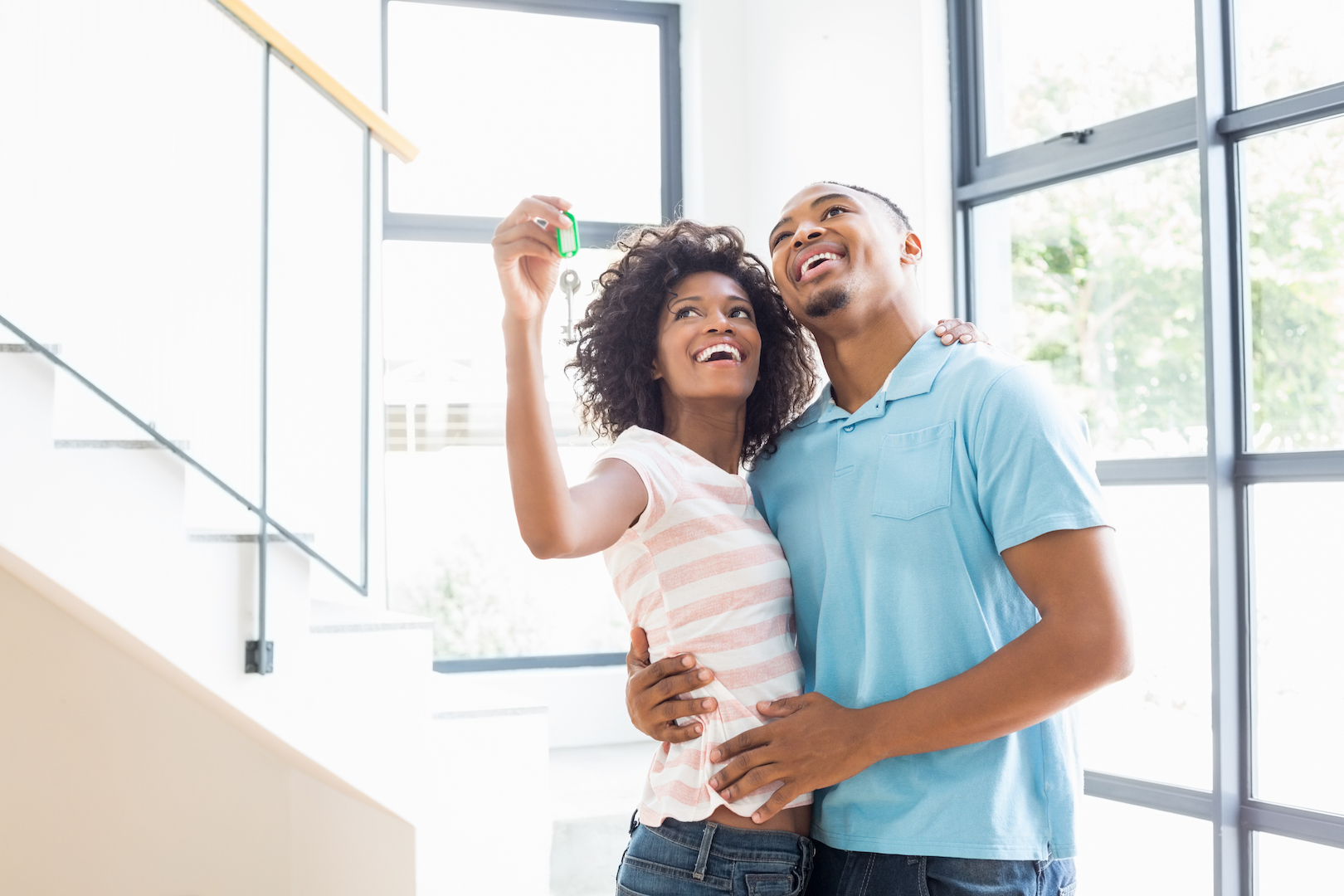 couple smiling with new house keys