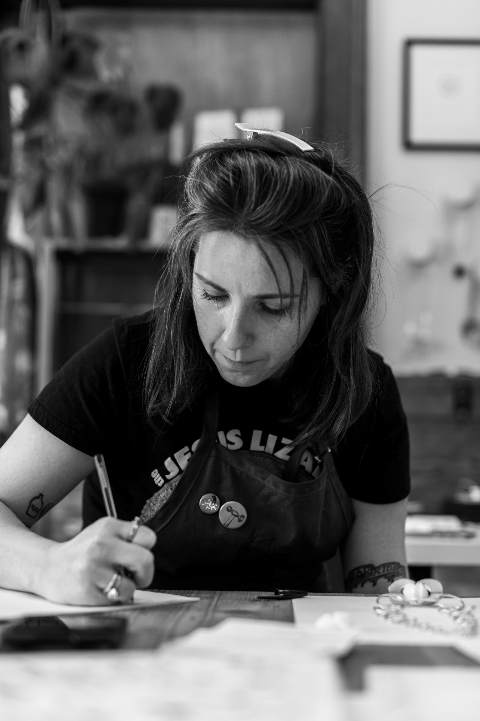 Sarah Rachel Brown writing at a desk