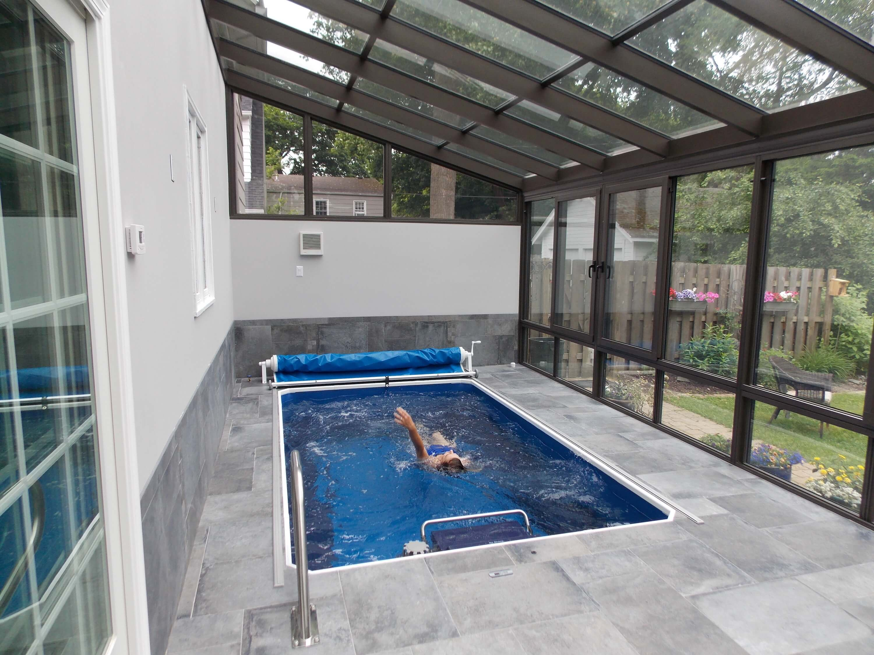 a fully in-ground Endless Pool in a pool enclosure in Rochester, New York