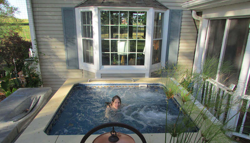 A woman enjoys the plunge pool experience in her Endless Pools WaterWell
