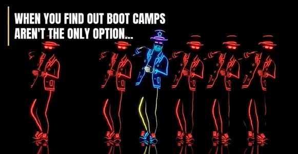 Snapshot of video with people performing a choreographed dance in the dark wearing suits that glow colorfully