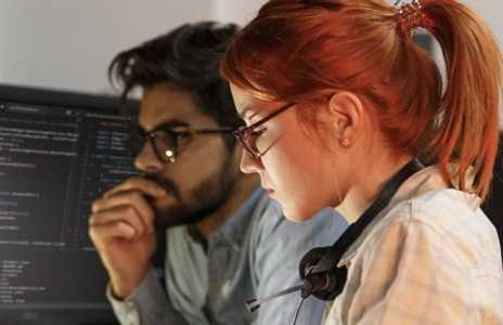 Two office workers in deep concentration