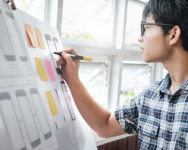 Person making a wireframe and storyboard for a mobile application