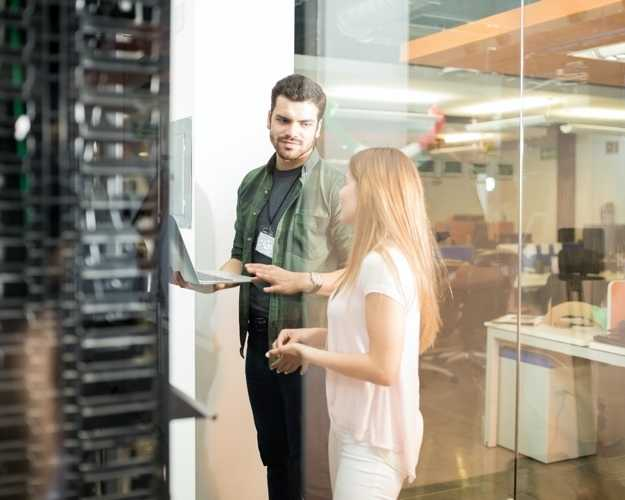 People talking at entrance of a server room