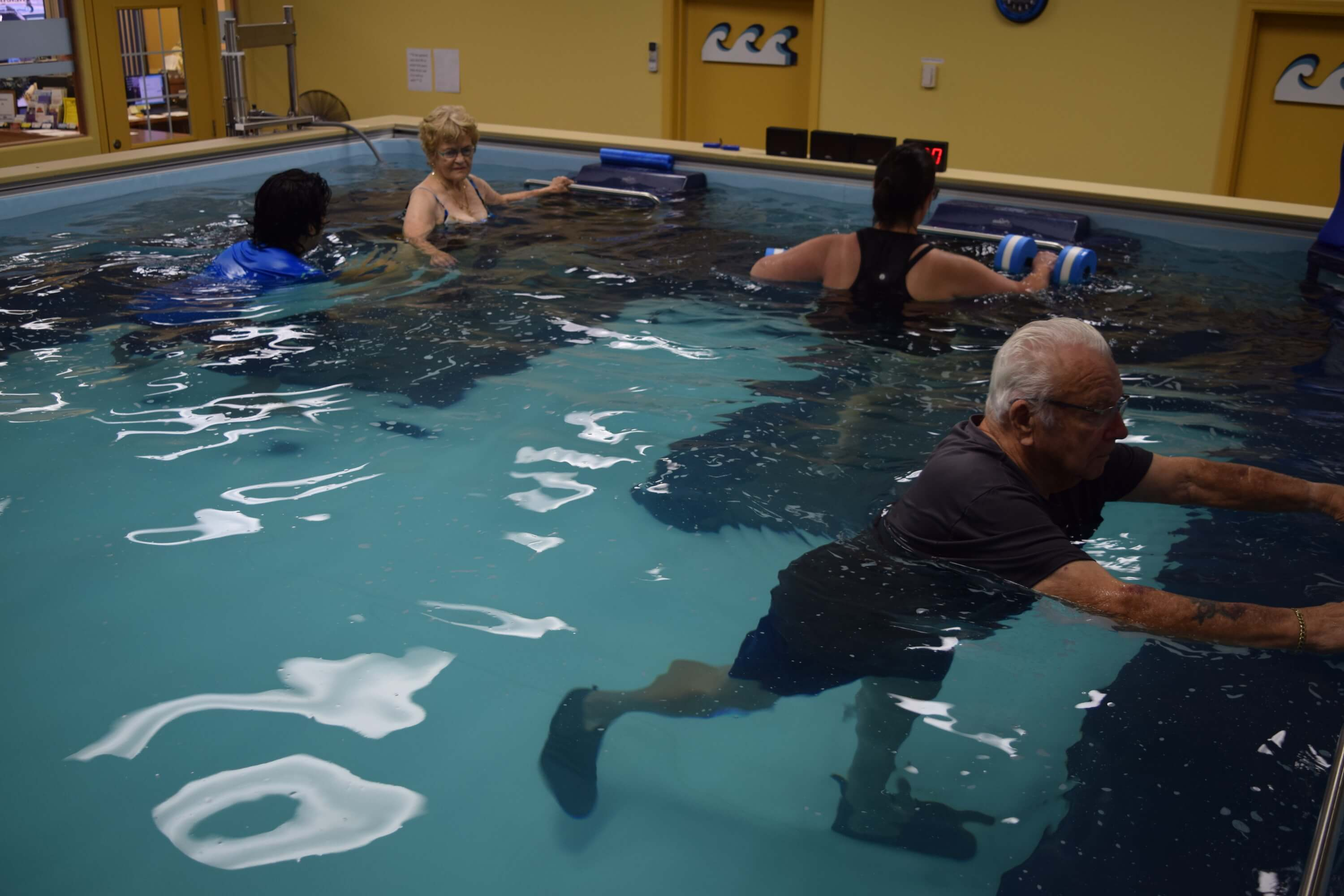 A Dual Propulsion Endless Pool serving 3 physical therapy patients at FYZICAL in Yuma