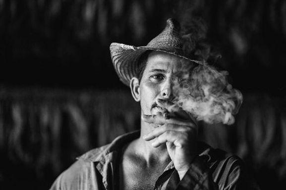 man smoking Cuba black and white
