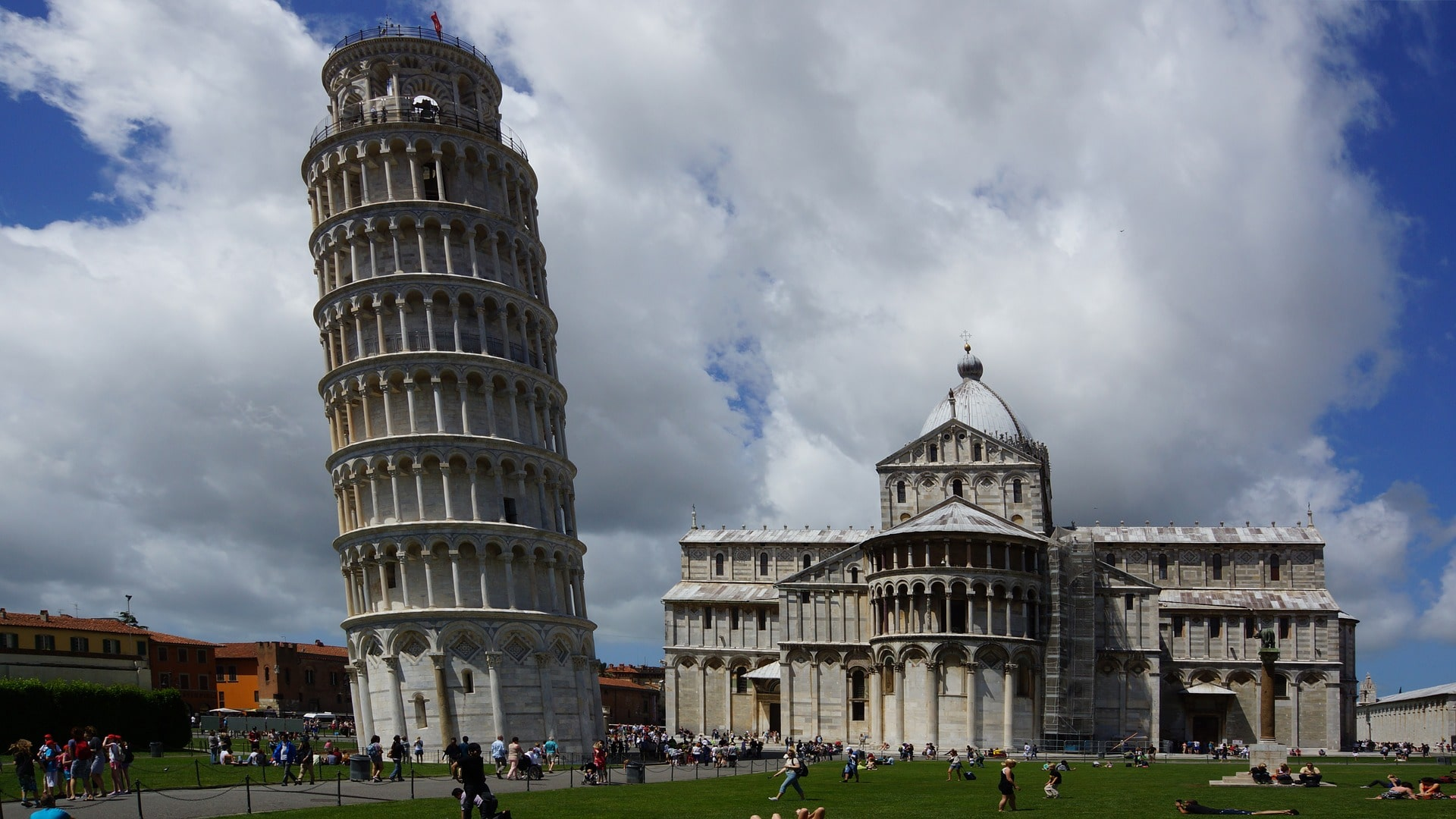 Taking a selfie at the Leaning Tower of Pisa is a fun thing to do in Italy