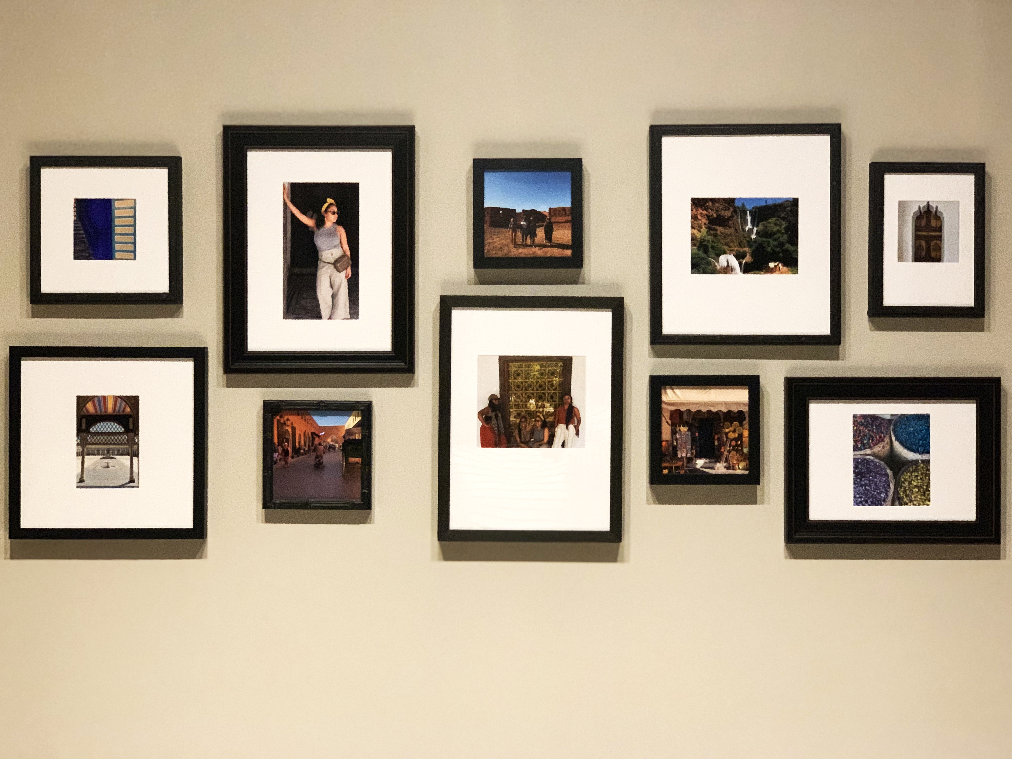 wide organic gallery wall with travel photos