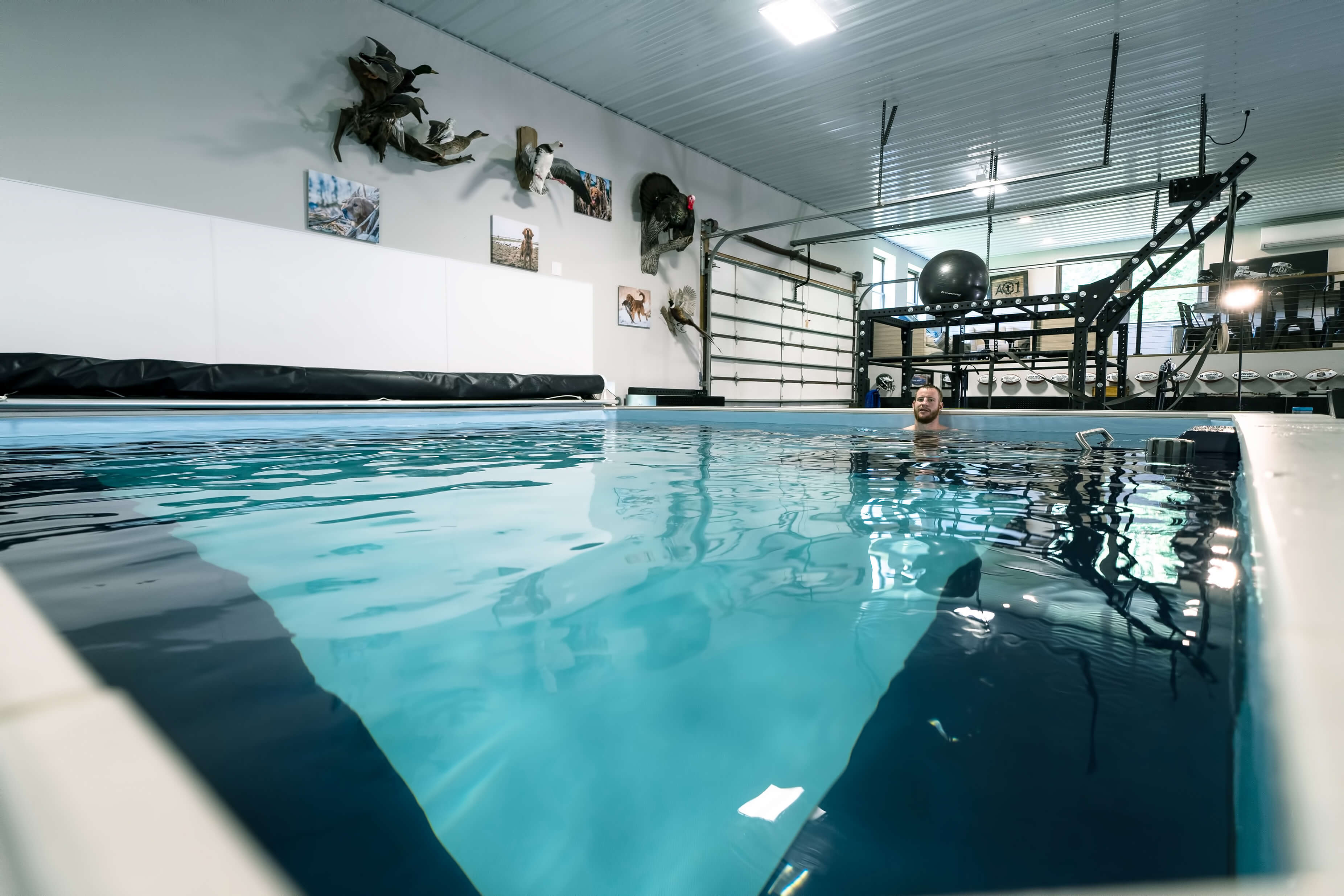 Philadelphia Eagles QB Carson Wents relaxes in the Endless Pools Elite model in his garage