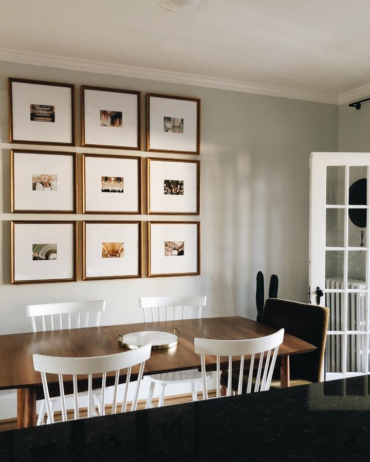 grid gallery wall above dining table