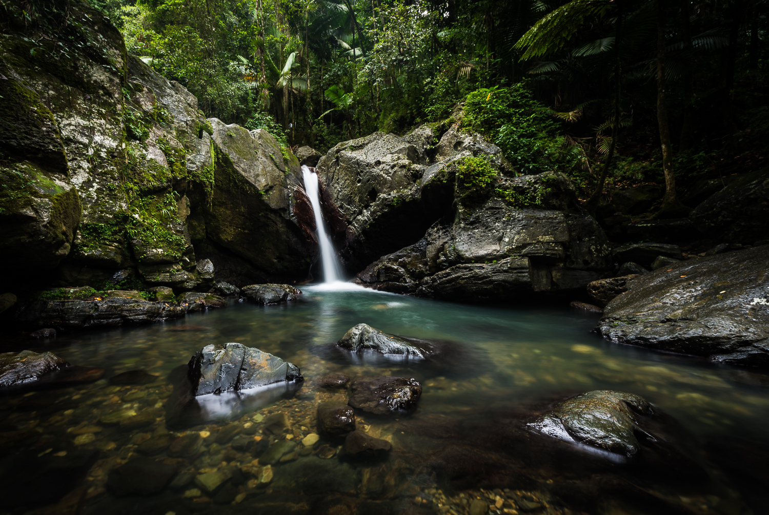 Cooling off in the El Yunque waterfalls is one of the fun things to do in Puerto Rico