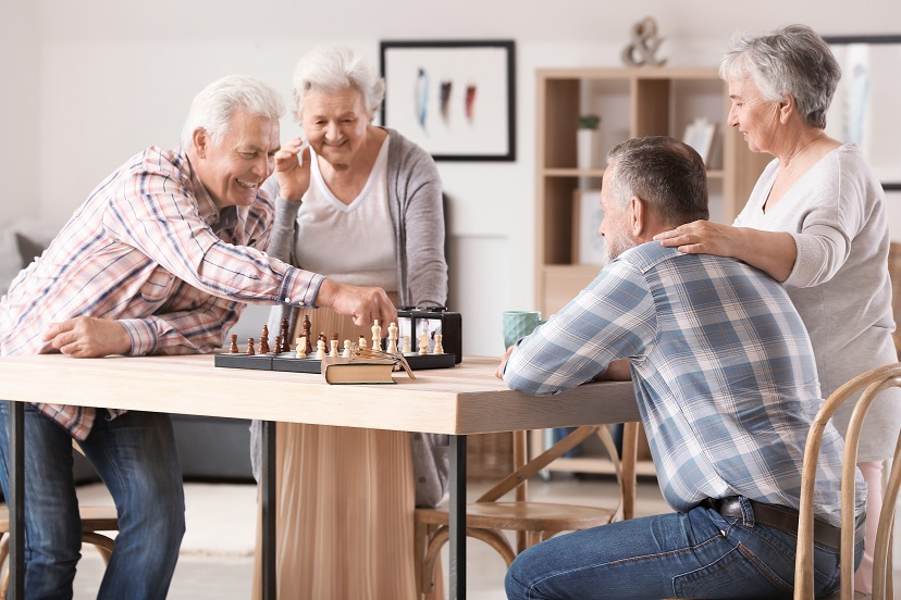 Senior couples playing board game, a Memory Care Activity for Alzheimer's or Dementia Patients