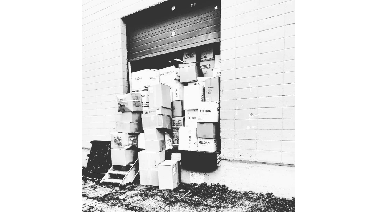 T-shirts from Gildan sitting on a loading dock waiting for screen printing.