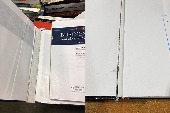 A photo of textbooks with either a damaged cover or damaged binding