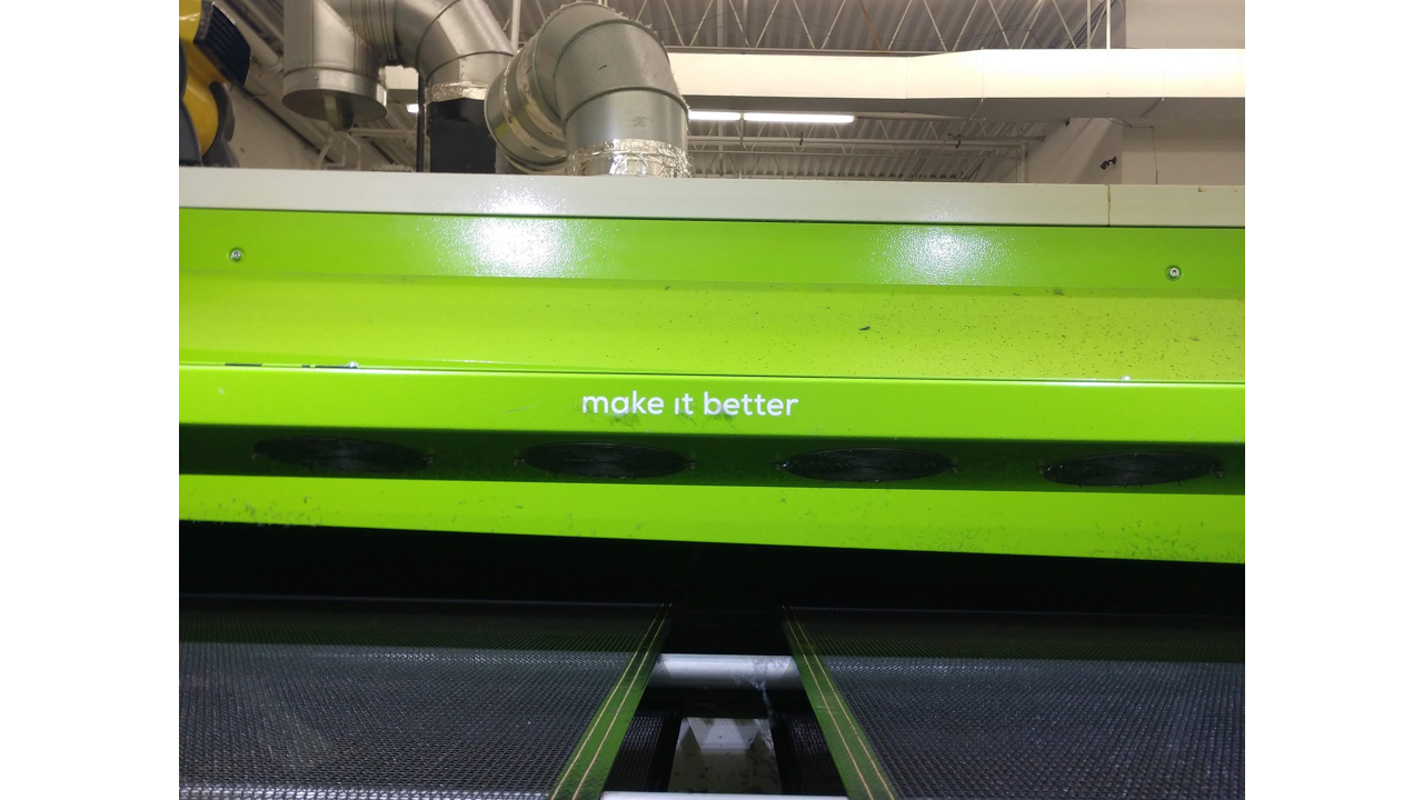 "A conveyor dryer for screen printing made by ROQ that says ""Make it better"""
