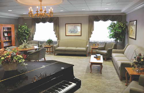 facility lounge area - what is a retirement home vs assisted living