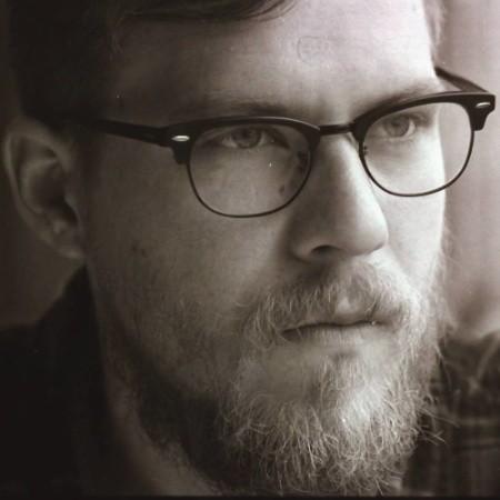 headshot of LUKE GARDNER,