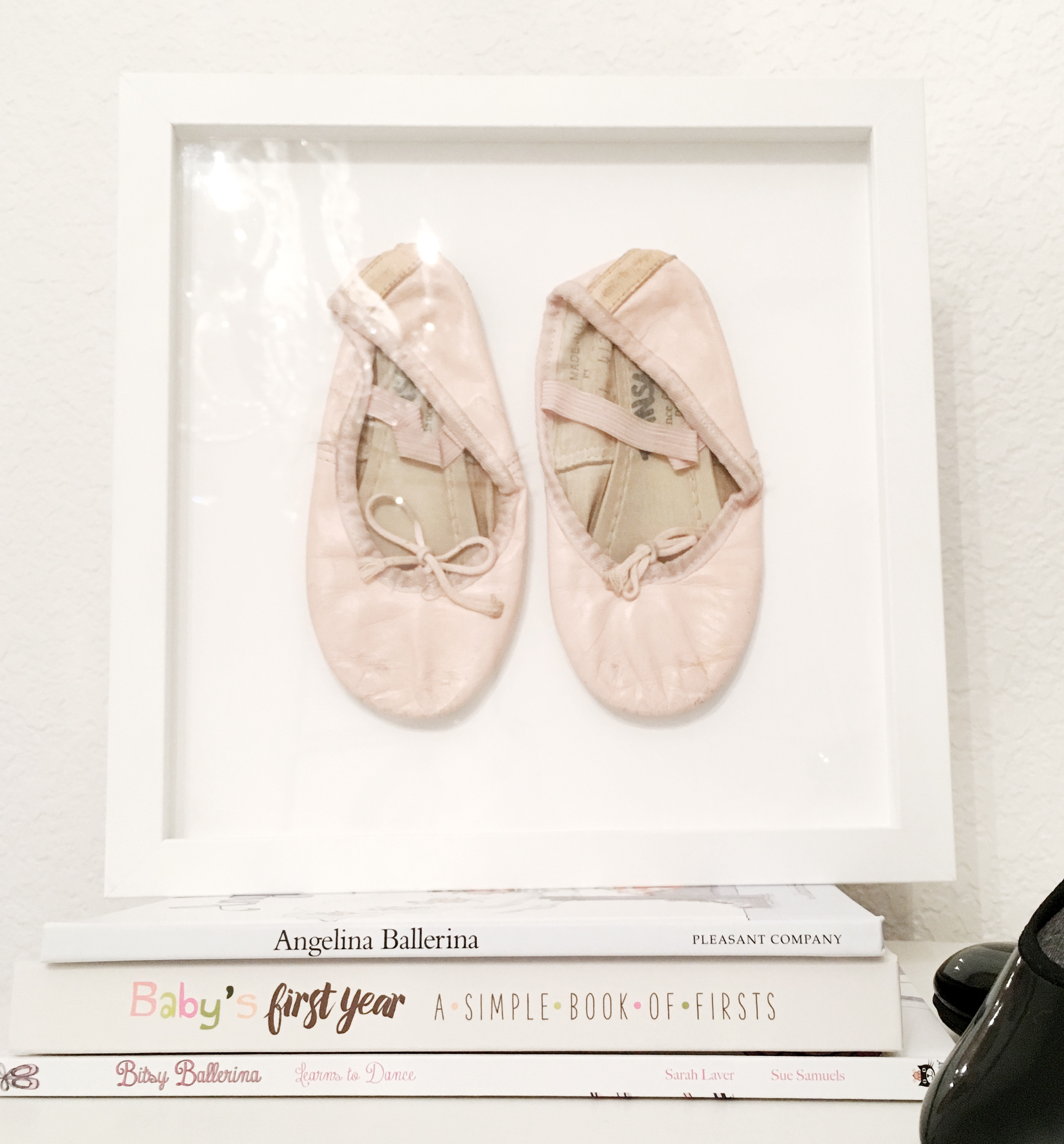 framed baby shoes, dancing shoes in shadowbox