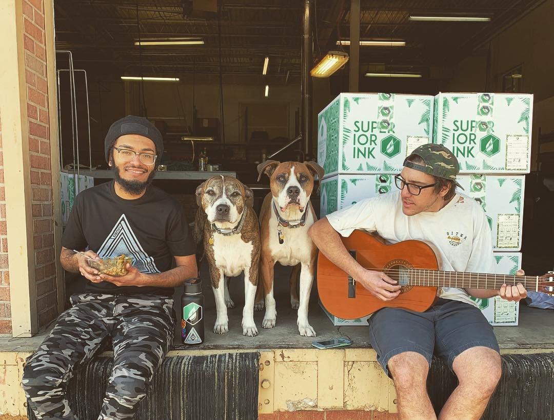 Superior Ink's team (and shop dogs) hang out during some downtime.