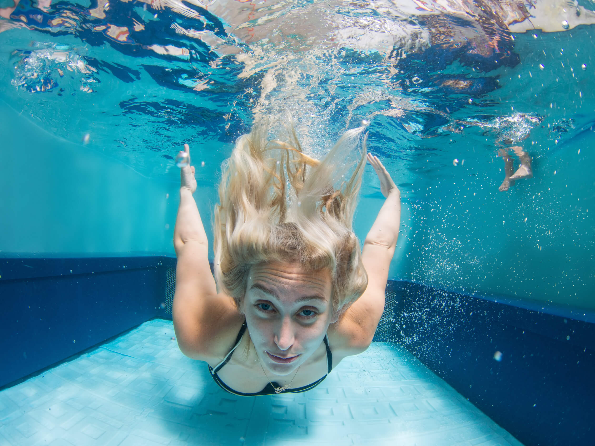 an underwater swimmer in an Original Endless Pools swimming machine