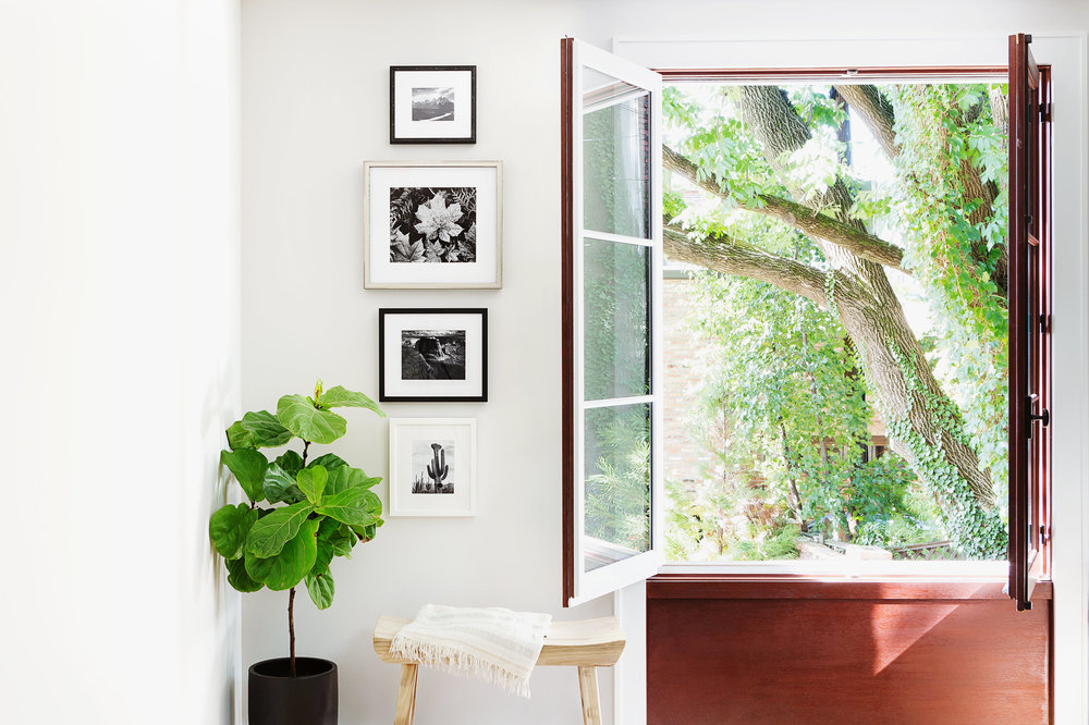 Ansel Adams Stacked Gallery Wall Next to Casement Window
