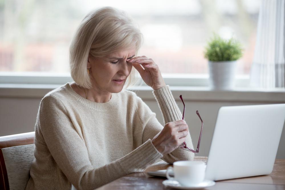 sad woman on laptop