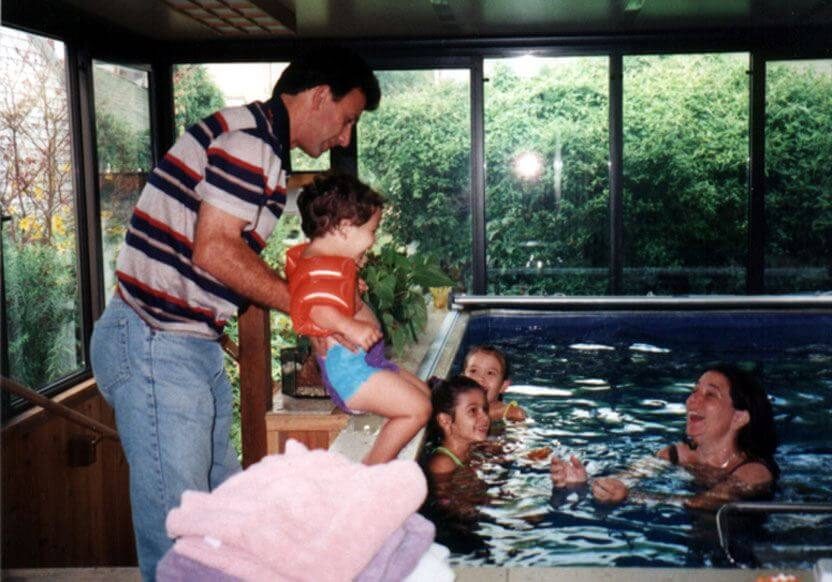 Fran Kaplan and her family in the Endless Pool in their sunroom