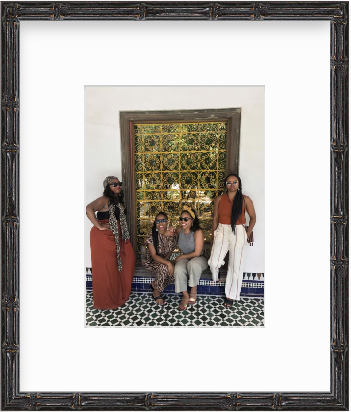 four women at Bahia palace in Morocco