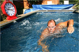open water swimmer Scott Richards using his backyard Endless Pool to train for his English Channel swim