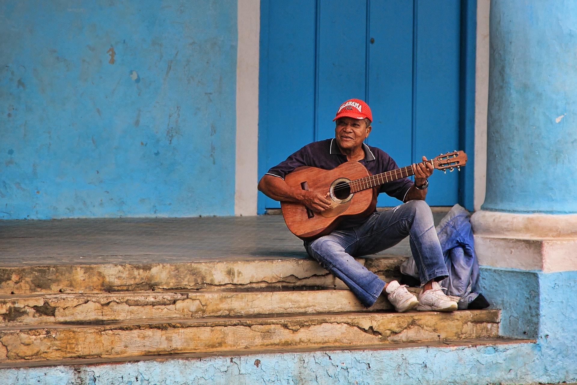 is cuba safe cuban local playing guitar