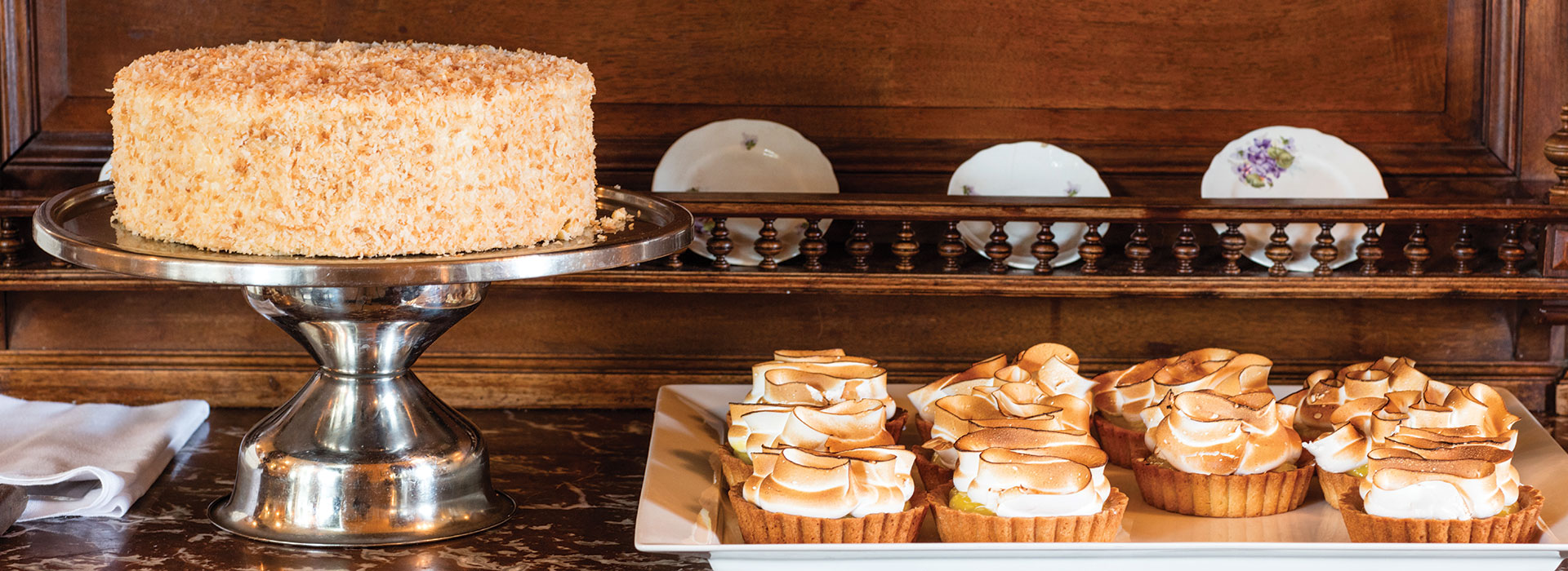 A shot of coconut cake and miniature pies.
