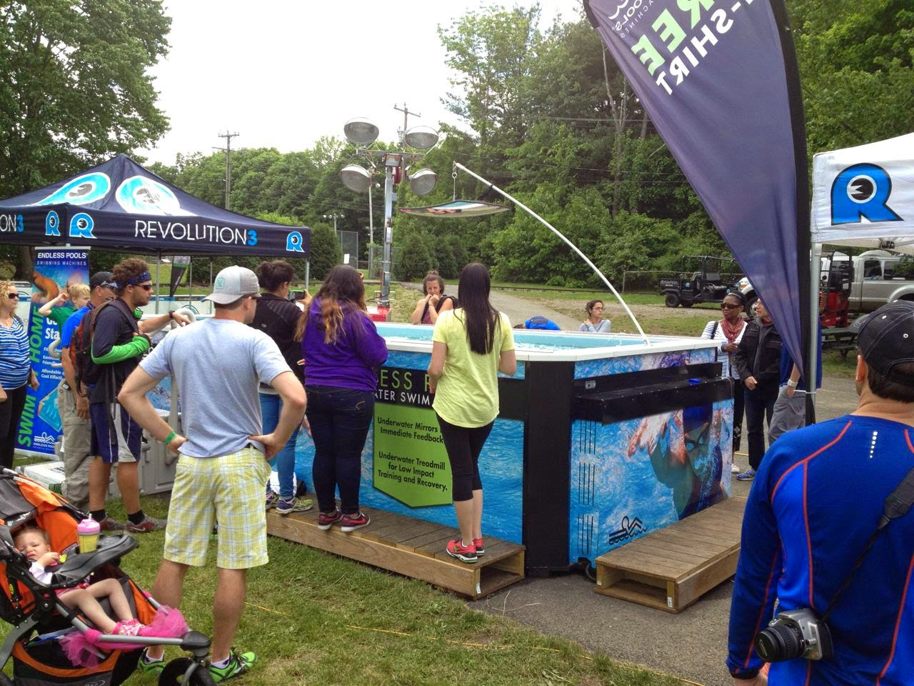 Athletes and spectators watch a test-swim in the Endless Pools Performance model at the REV3 Triathlon at Quassy Amusement Park last weekend.