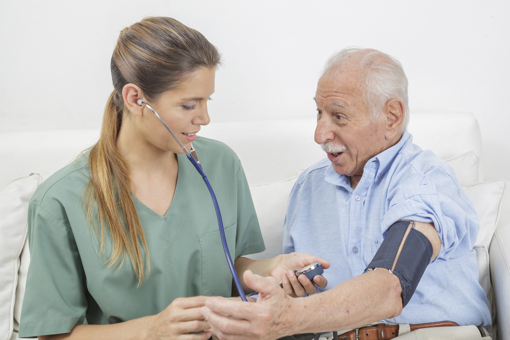 alternative treatment for hypertension - doctor with patient
