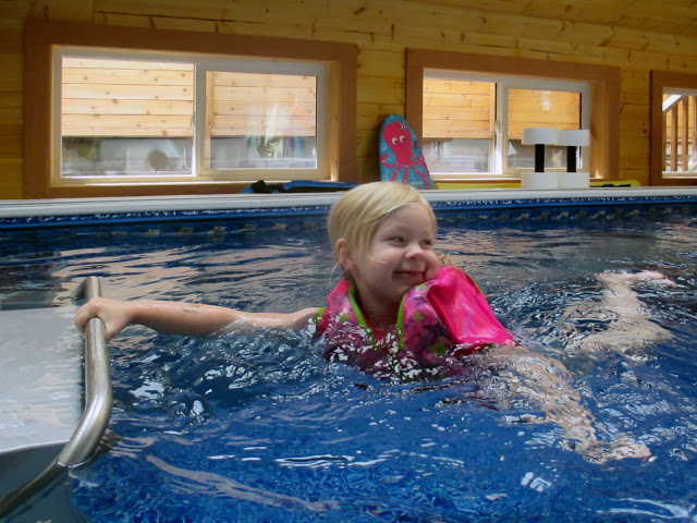 a young girl at play in an Endless Pools swimming machine