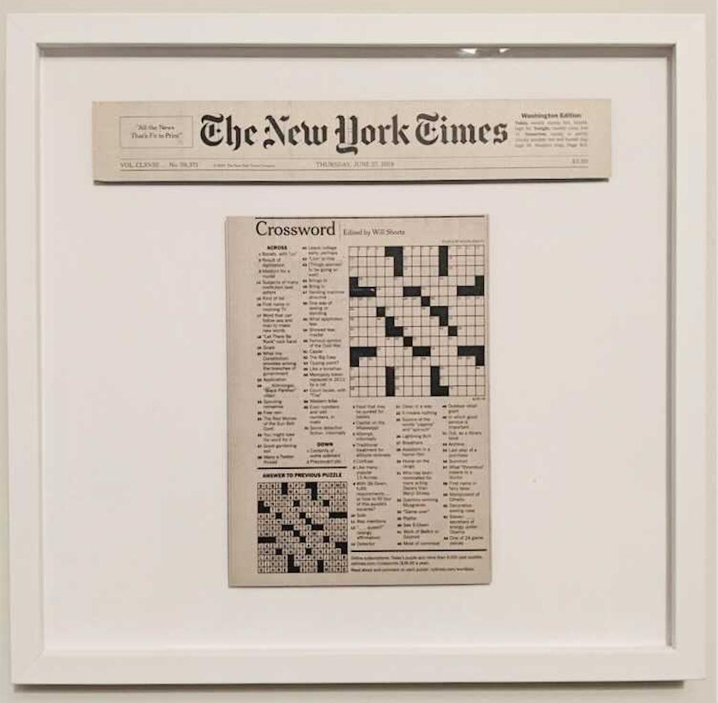 framed blank New York Times crossword puzzle in white frame