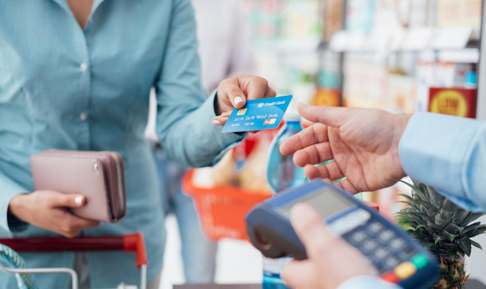 women paying at the store with her card