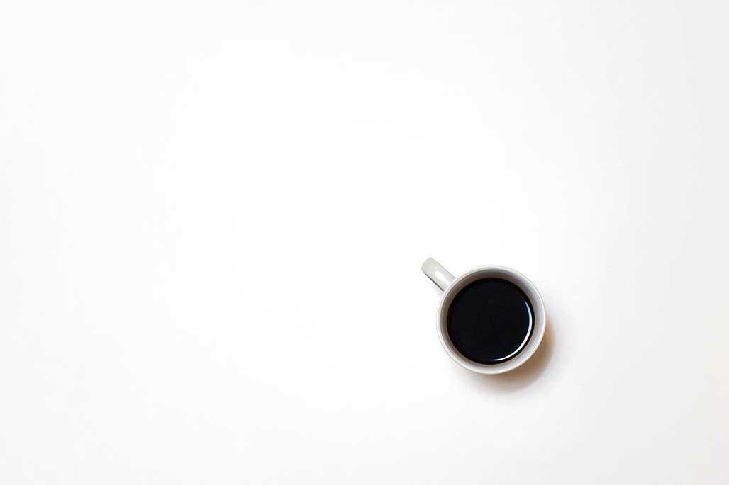 CoffeeinWhiteCup-IsaacBenhesed-Unspla...