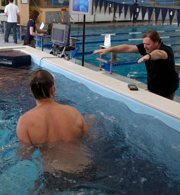 Olympic swimmer and swimming instructor Glenn Mills offering swim technique tips with the Elite Endless Pool at Friends' Central School