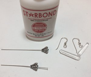 Crystals, earring findings, bead cones, headpins and starbond used to make earrings