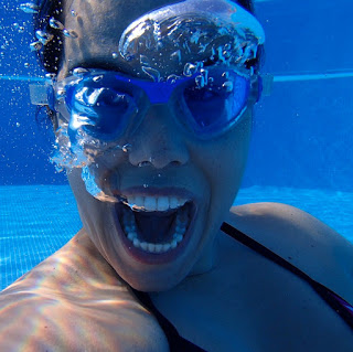 a swimmer underwater in a swimming pool