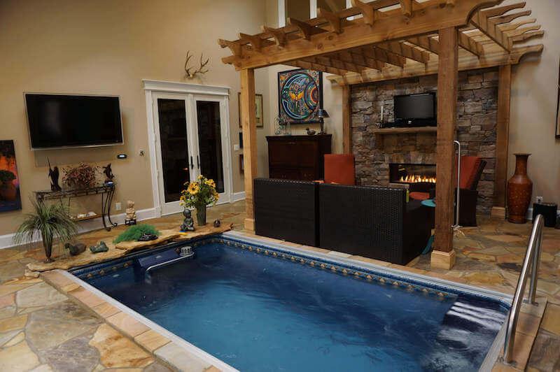 in-ground Original Endless Pool indoors in a rec room