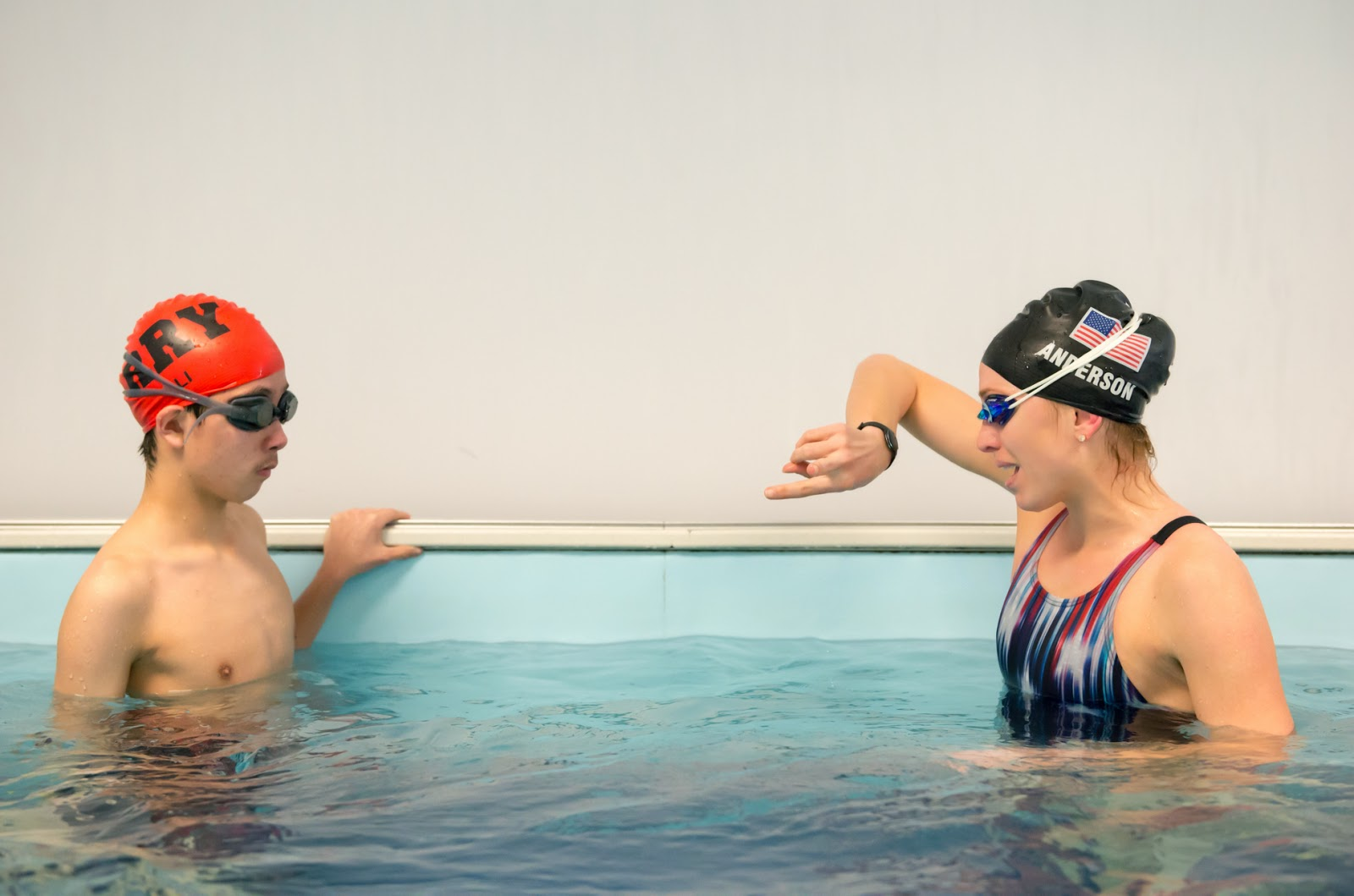 Olympian Alyssa Anderson gives pointers to 13-year-old Andrew Li in the Elite Endless Pool