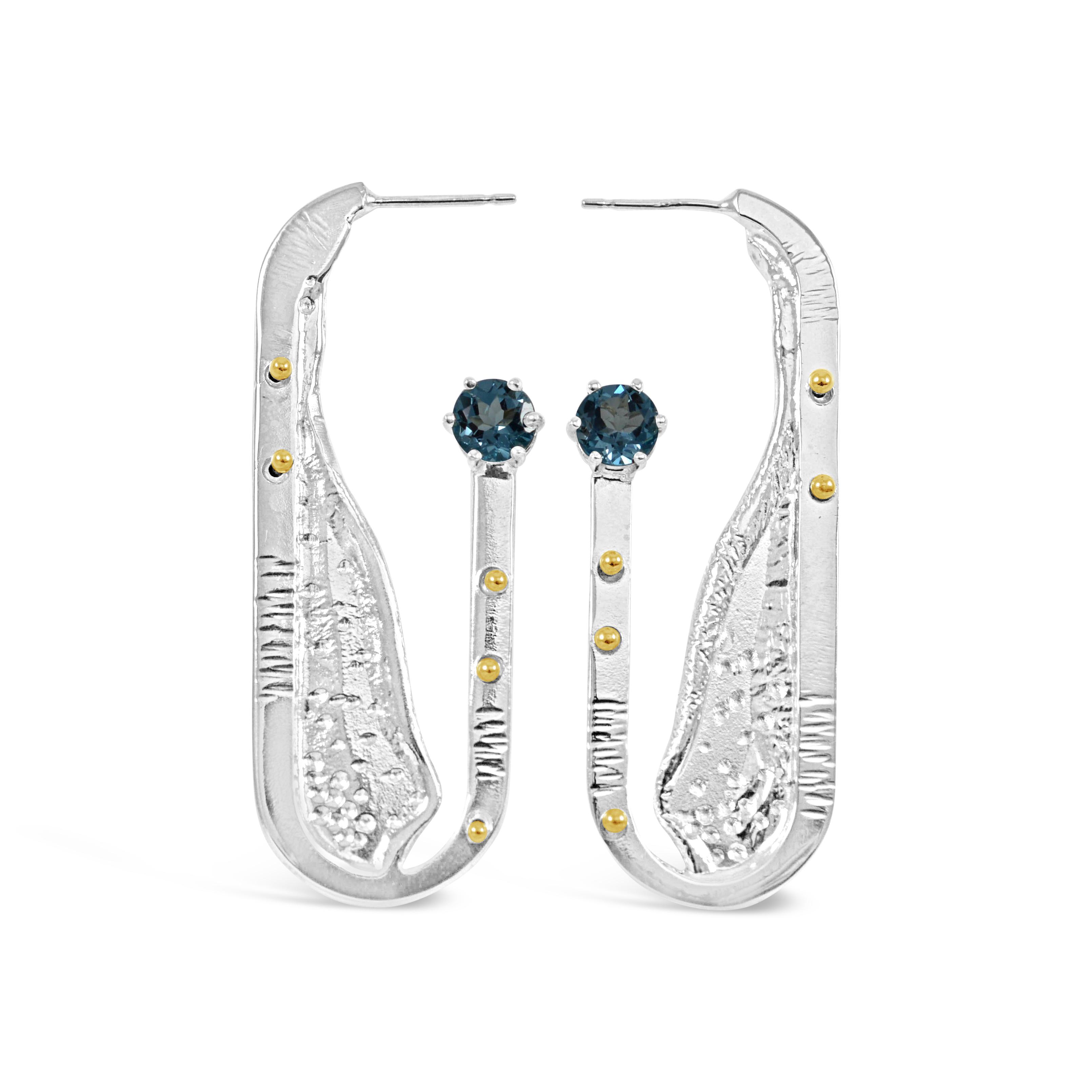 Earrings with blue stones by Kristen Baird