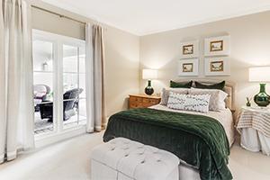 Infinity from Marvin replacement casement fiberglass windows in bedroom